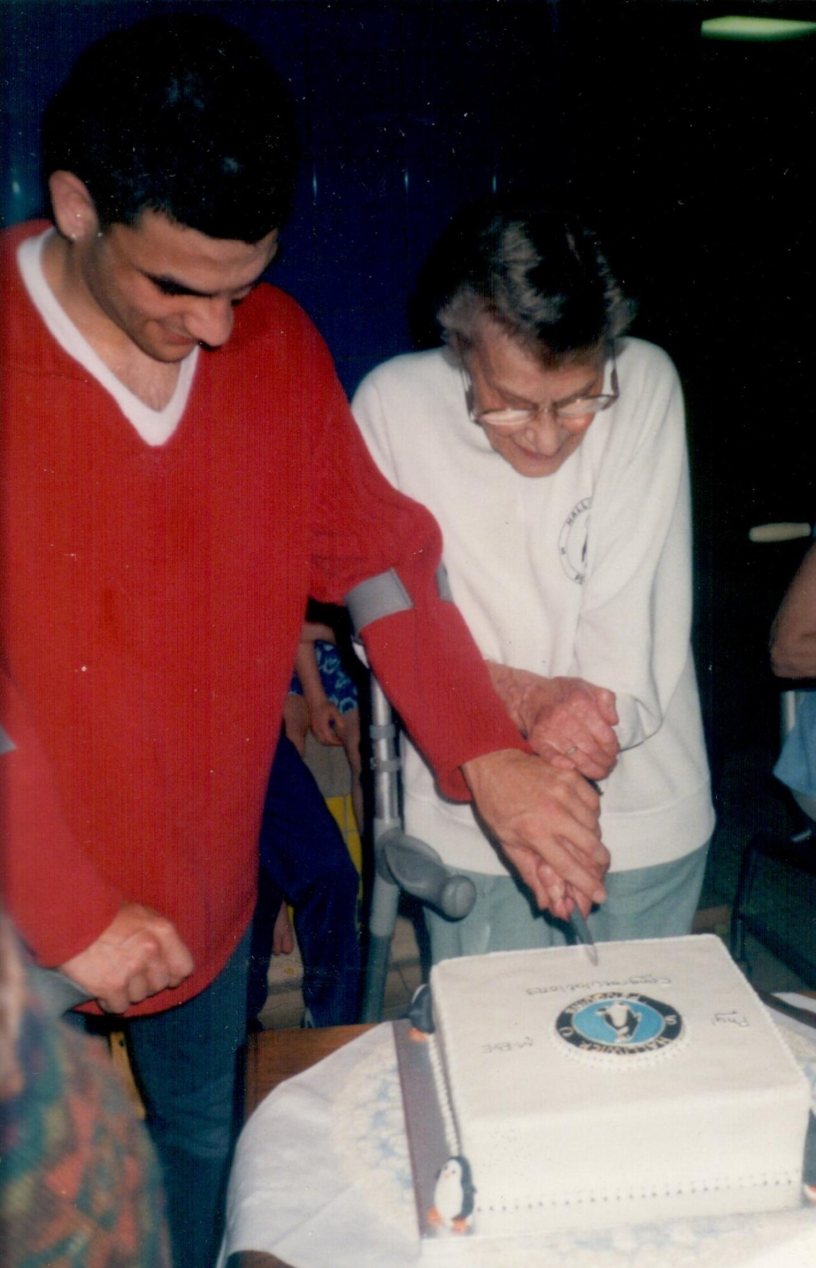 Cutting Cake at Pool (MBE Celebration)